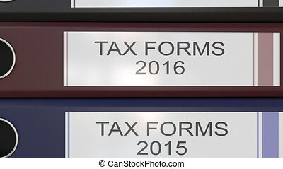 Vertical stack of multicolor office binders with Tax forms...
