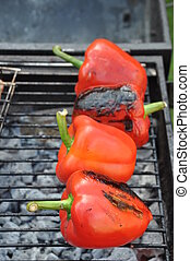 Grilling red peppers - grilling red peppers on a outdoor...