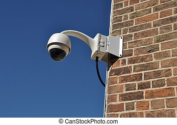 Security camera - surveillance camera attached on a brick...