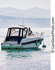 Motor boat in Geneva Lake in Lausanne, Switzerland