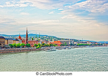 Cruises and Buda City with Churches Spires at Danube River...