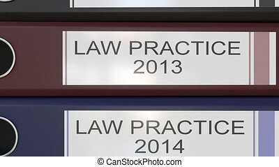 Vertical stack of multicolor office binders with Law...