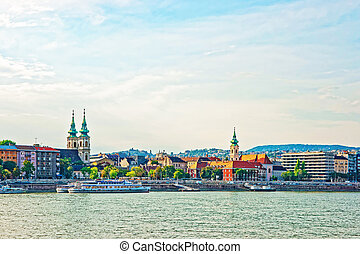 Ferry and Buda City with University Church Spire at Danube -...