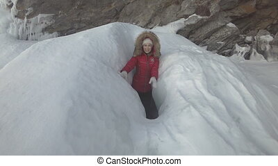 Woman is a tourist in the ice of Lake Baikal. - A woman is a...