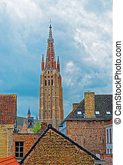 Church of Our Lady in medieval old city of Brugge - Street...