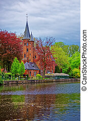 Minnewaterpark and Minnewater lake in old city in Brugge