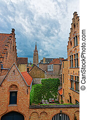 Church of Our Lady in medieval old city in Brugge - Street...