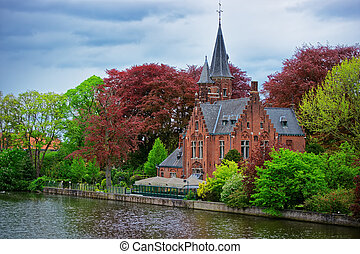 Minnewaterpark and Minnewater lake in old city of Brugge