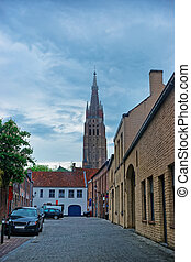 Church of Our Lady in old city in Brugge - Street view on...