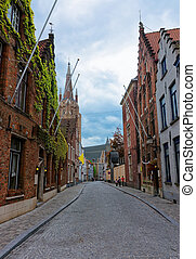 Church of Our Lady in old town of Brugge - Street view on...