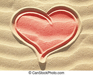 Red colored heart drawing on sand