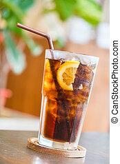 Cola glass with lemon