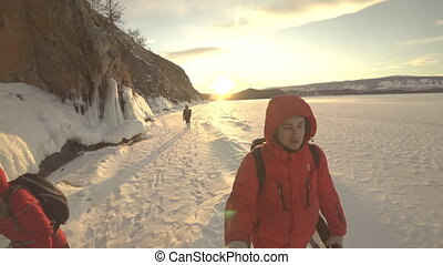 Two tourists and travelers on the ice. - Two tourists and...