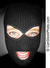 A stock photograph of an attractive woman wearing a balaclava.