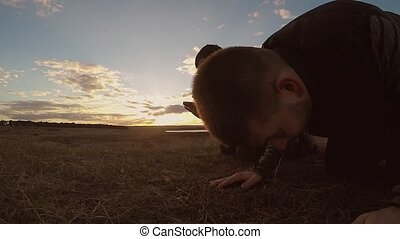 Religious two men muslim the man praying nature sunset...