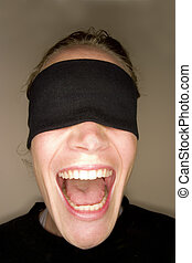 A stock photograph of a blindfolded woman.