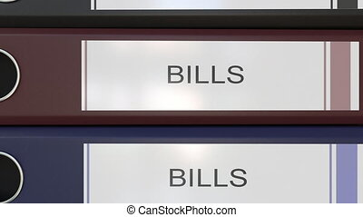Vertical stack of multicolor office binders with Bills tags....