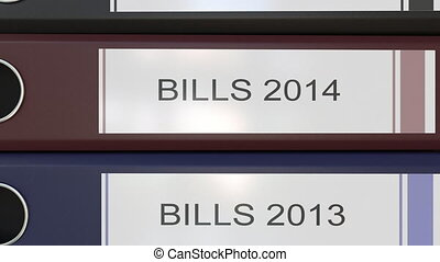 Vertical stack of multicolor office binders with Bills tags...