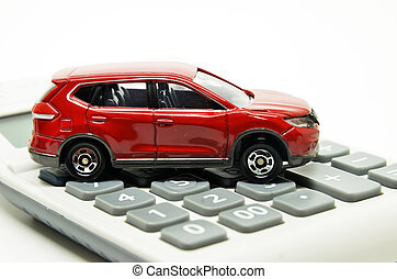 Calculator and red toy car