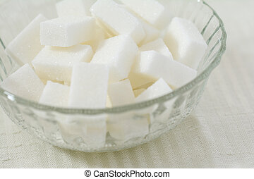 Cubes of white sugar in a crystal bowl - Closeup of cubes of...