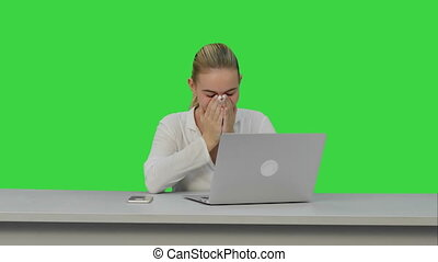 Young secretary tired at work place, yawn on a Green Screen,...