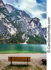 Bench on lake beach. Magnificent lake in South Tyrol, Italy....