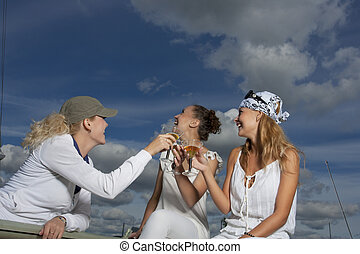 having fun together - three young girls having nice time on...