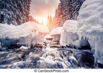 winter river at forest - Miracle river at sunlight in the...