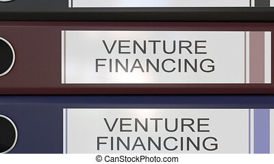 Vertical stack of multicolor office binders with Venture...