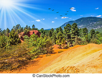 The color of ocher - Unique red and orange hills in the...