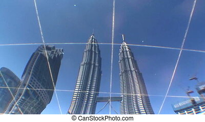 Kuala Lumpur Towers Reflection - Reflection in water of the...