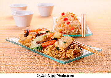 Chow Mein - Chow mein noodles topped with chicken and...
