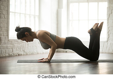 Young attractive sporty woman doing Warming up, loft studio...