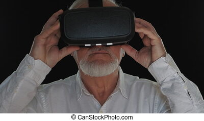 Closeup of senior man using virtual reality headset, VR mask...