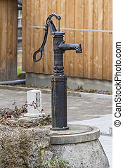 nostalgic water pump - rural scenery including a nostalgic...