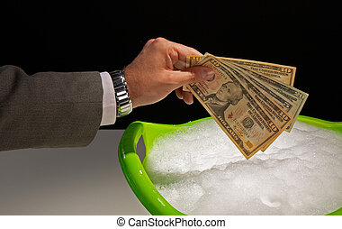 Money laundering - Putting dollar banknotes to soak, money...