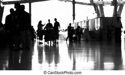 Airport People Black and White - People walking in an...
