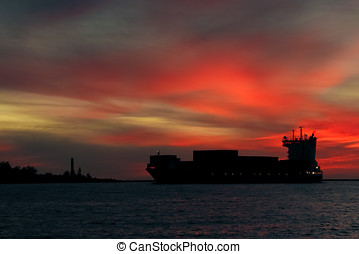Large container ship silhouette arriving from Baltic sea at...
