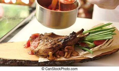 Steak with sauce and vegetables. Grilled meat and green...