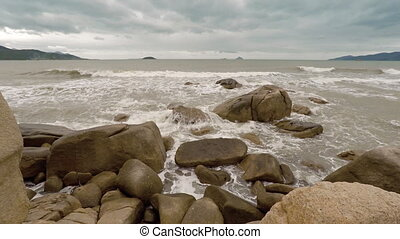 Waves splash over the Hon Chong Rocks near Nha Trang,...