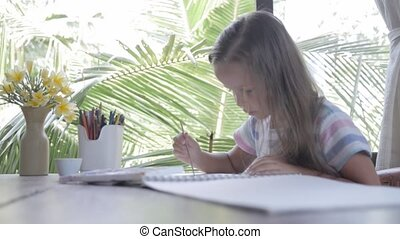 Child artist painting watercolor paints
