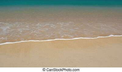 Gentle Waves Lapping at the Sand on Tropical Beach. FullHD...