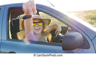 Woman smiling showing new car keys