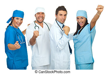 Excited group of doctors with achievements raising hands...