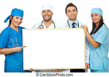 Team of doctors with blank banner - Happy team of four...