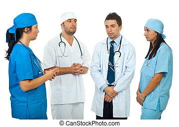 Sad team doctors have a discussion - Four doctors team...