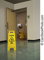 Restroom Mop Safety - A Caution Sign warns people of a wet...