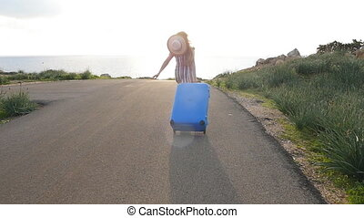 Happy traveler woman running with suitcase. Travel concept