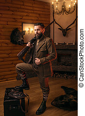Respectable hunter man with old gun in retrro style...