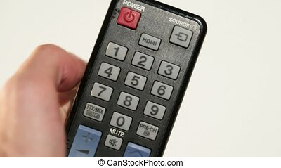 Person with remote controller - Person with TV remote...